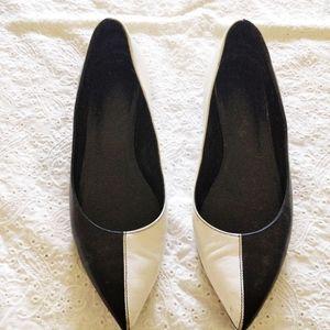 Saint Laurent black and white point toe flats.